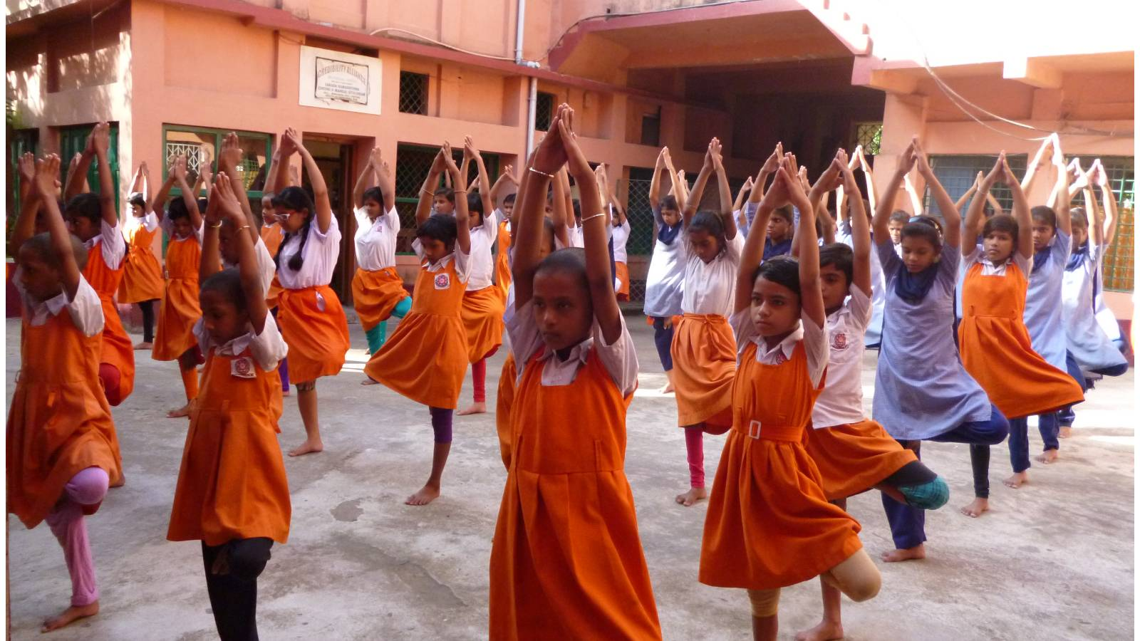 Girls students are performing Yoja