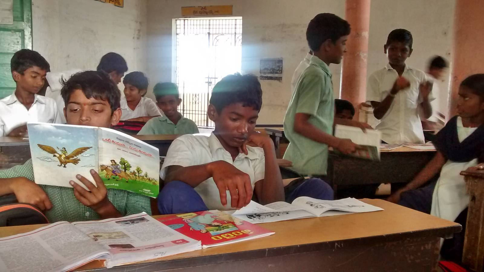 Students reading BREAD books