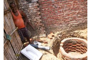 Sponsor the construction of a low cost toilet for a poor family in the villages of Bihar