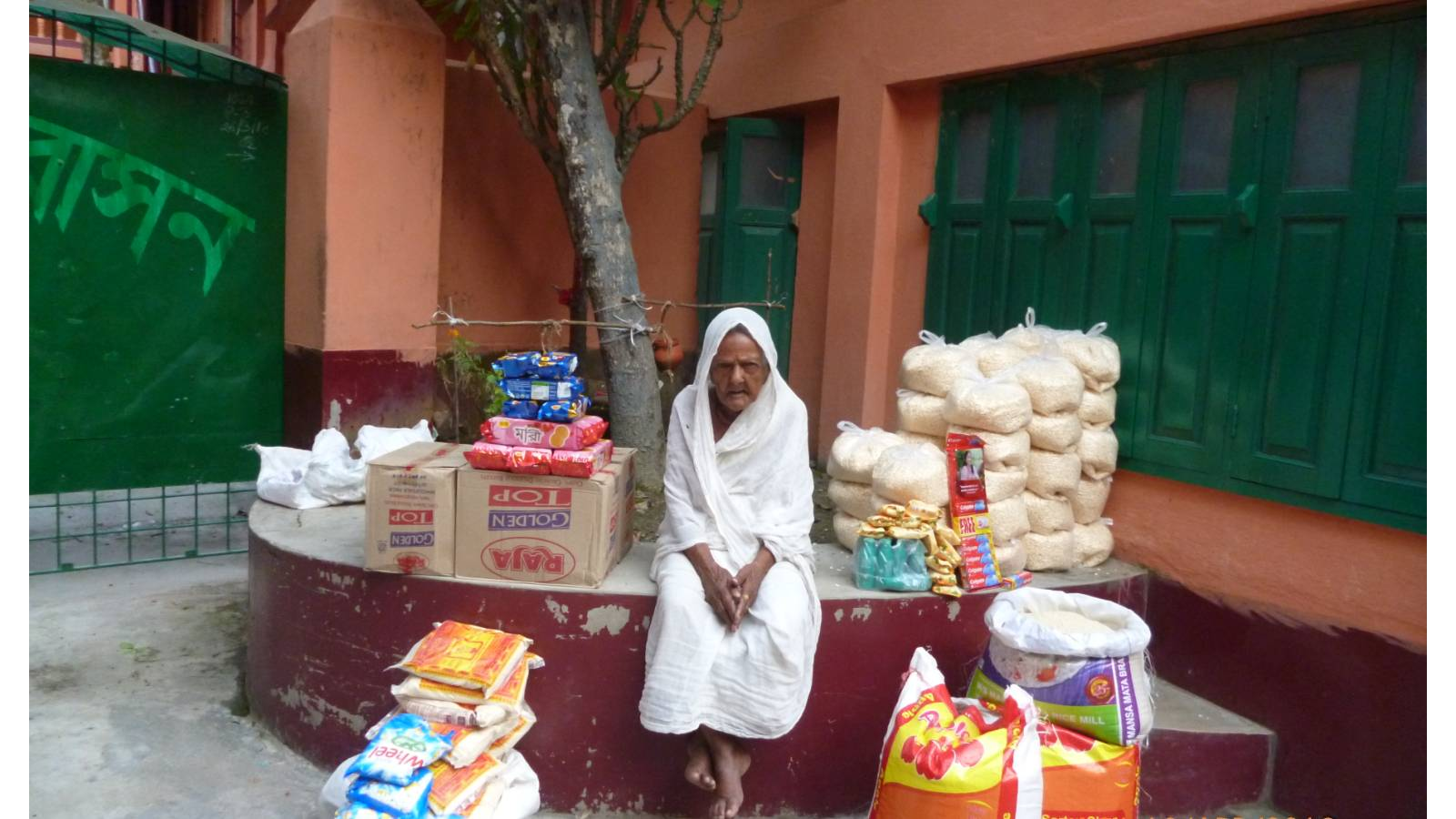 Poor and very old women are being distributed nutritious food and health case items / things